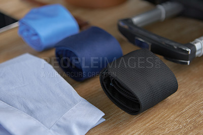 Buy stock photo High angle shot of formal wear and the handle of a suitcase on a wooden surface