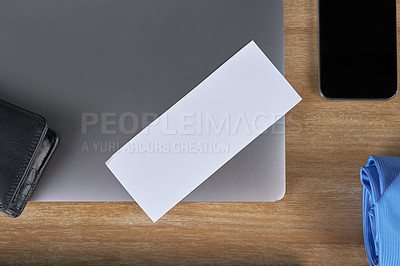 Buy stock photo High angle shot of various electronic devices on a wooden table