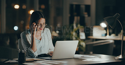 Buy stock photo Cropped shot of an attractive young businesswoman sitting alone and using her cellphone and laptop in the office at night
