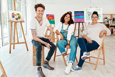 Buy stock photo Cropped portrait of a diverse group of friends sitting together during an art class in the studio
