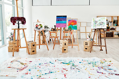 Buy stock photo Cropped shot of painted canvas on easels in an empty studio after an art class during the day