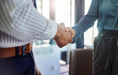Buy stock photo Cropped shot of two unrecognizable businesspeople shaking hands