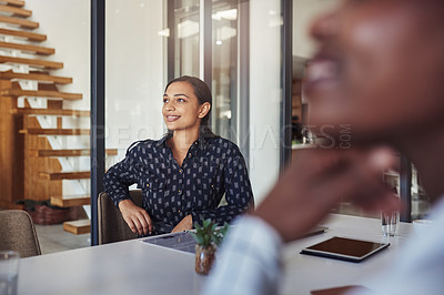 Buy stock photo Cropped shot of a businesswoman sitting in the boardroom with her colleagues