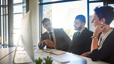 Buy stock photo Cropped shot of a group of businesspeople working together at the office