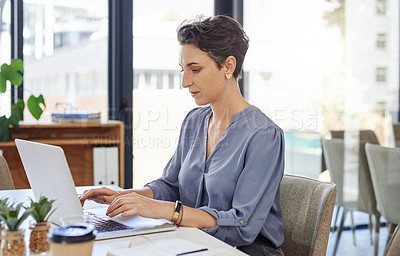 Buy stock photo Cropped shot of a businesswoman using her laptop at the office