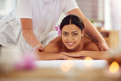 Buy stock photo Cropped portrait of an attractive young woman lying on a massage table in a beauty spa
