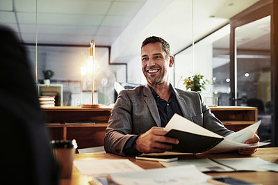 Buy stock photo Shot of a mature businessman having a late night meeting in a modern office