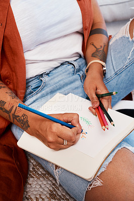 Buy stock photo Cropped shot of an unrecognizable woman drawing at home