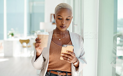 Buy stock photo Shot of a young businesswoman using a cellphone while drinking coffee in an office