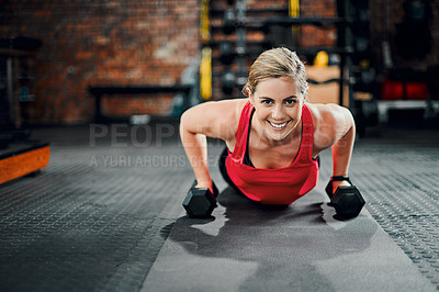 Buy stock photo Full length portrait of an attractive young female athlete working out with dumbbells in the gym