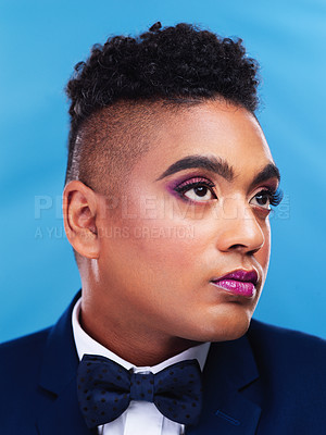Buy stock photo Cropped shot of a gender fluid businessman posing against a blue background