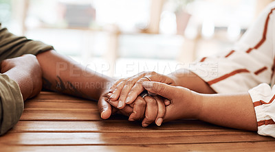 Buy stock photo Cropped shot of two unrecognisable women holding hands at cafe table