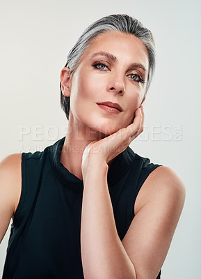 Buy stock photo Studio portrait of a beautiful mature woman posing against a grey background