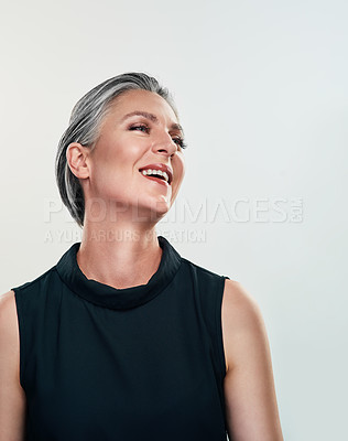 Buy stock photo Studio shot of a beautiful mature woman posing against a grey background