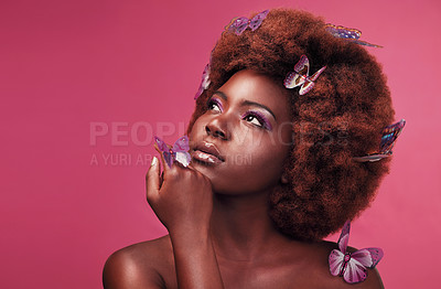 Buy stock photo Studio shot of a beautiful young woman posing topless with butterflies in her hair against a purple background