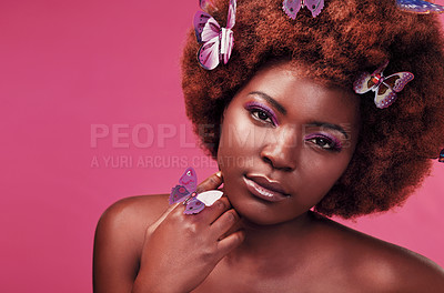 Buy stock photo Studio portrait of a beautiful young woman posing topless with butterflies in her hair against a purple background