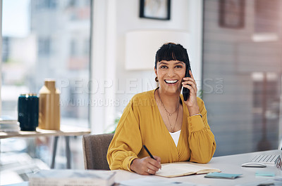 Buy stock photo Cropped portrait of an attractive young businesswoman sitting alone in her office and using her cellphone