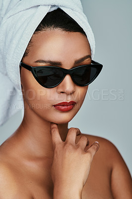 Buy stock photo Cropped shot of a beautiful young woman posing with sunglasses and red lipstick