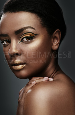 Buy stock photo Cropped shot of a beautiful young woman wearing gold makeup against a grey background