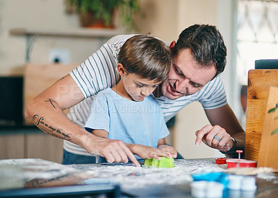 Buy stock photo Shot of an adorable little boy baking with his father at home