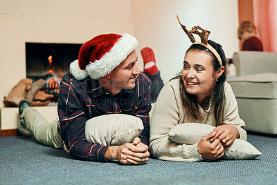 Buy stock photo Shot of a happy young couple spending quality time together at Christmas