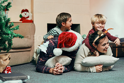 Buy stock photo Shot of a happy young family of four spending quality time together at Christmas
