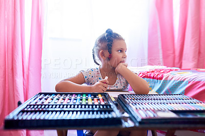 Buy stock photo Cropped shot of an adorable little girl looking thoughtful while drawing in her bedroom at home