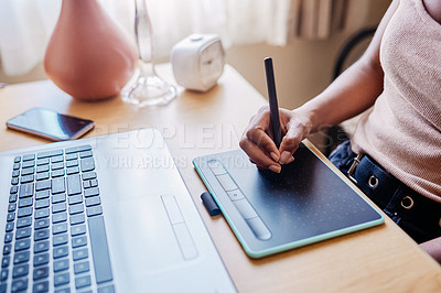 Buy stock photo Cropped shot of an unrecognizable female university student using a drawing pad to draw on her laptop in her room