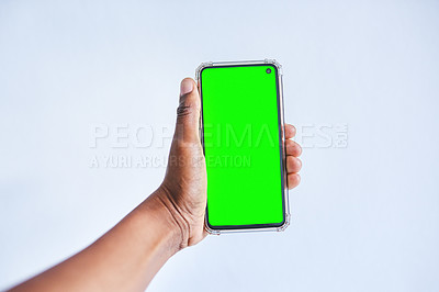 Buy stock photo Cropped shot of an unrecognisable person holding up a cellphone against a white background