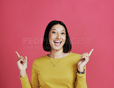 Buy stock photo Cropped portrait of an attractive young woman standing and making a hand gesture against a pink background in the studio