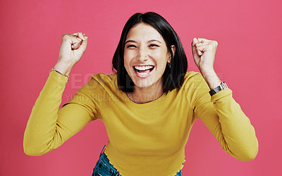 Buy stock photo Cropped portrait of an attractive young woman standing alone and feeling accomplished against a pink background in the studio