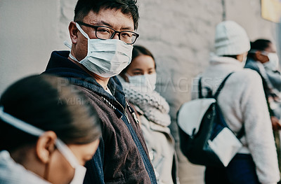 Buy stock photo Shot of a young woman wearing a mask while travelling in a foreign city