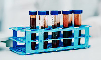 Buy stock photo Shot of vials of blood on a table in a laboratory