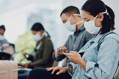 Buy stock photo Shot of a group of young people wearing masks while waiting together in an airport lounge