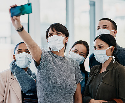 Buy stock photo Shot of a group of young people wearing masks and taking selfies at the airport