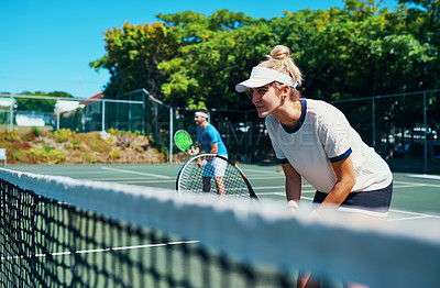 Buy stock photo Cropped shot of a mixed doubles tennis team playing together on a tennis court outdoors