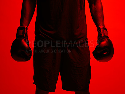 Buy stock photo Red filtered shot of a sportsman  wearing boxing gloves