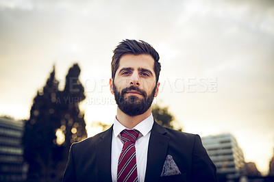 Buy stock photo Cropped portrait of a handsome young businessman standing outdoors in a foreign city