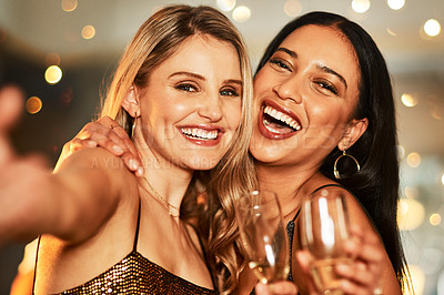 Buy stock photo Portrait of two cheerful young women taking a self portrait together inside of a bar at night