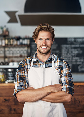 Buy stock photo Cropped shot of a young shop owner looking happy while standing in his cafe