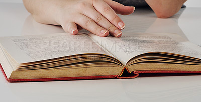 Buy stock photo Cropped shot of an unrecognizable woman going through a cook book in an empty kitchen