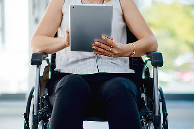 Buy stock photo Cropped shot of an unrecognizable businesswoman using a digital tablet in the office