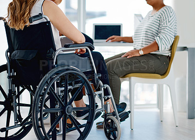Buy stock photo Shot of a businesswoman with disabilities sitting with colleagues in the office