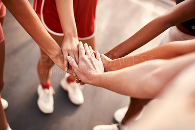 Buy stock photo Cropped shot of an unrecognizable group of sportswomen piling their hands together before a basketball game