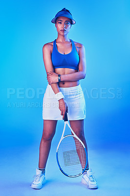 Buy stock photo Full length portrait of an attractive young female tennis player posing against a blue background