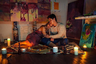 Buy stock photo Shot of a cheerful young couple  relaxing together while having a date surrounded by candles and paintings inside of an art studio