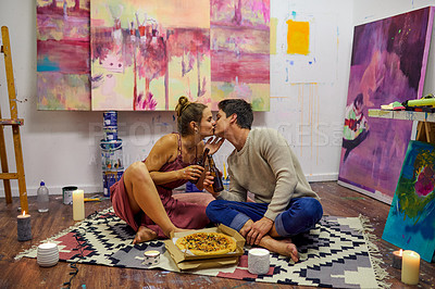 Buy stock photo Shot of a cheerful young while having a date surrounded by candles and paintings inside of an art studio