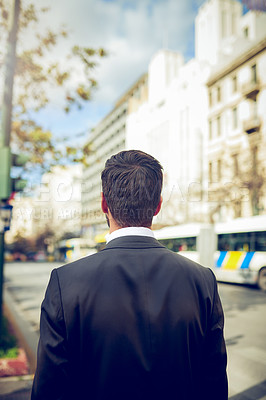Buy stock photo Rearview shot of a young businessman in the city