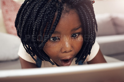 Buy stock photo Cropped shot of an adorable little girl having fun while using a digital tablet at home