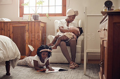 Buy stock photo Full length shot of a young mother bonding with her two adorable young daughters at home